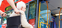 Picture of a disabled person boarding a bus